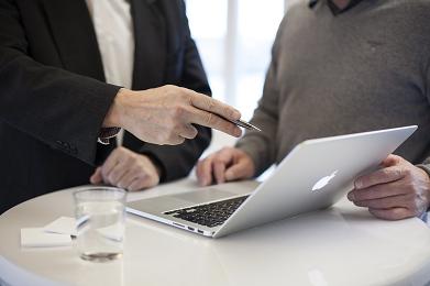 professional business plan writer explaining